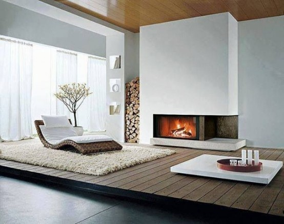 a raised plywood platform by the fireplace highlights this cozy nook and separates it from the rest of the space