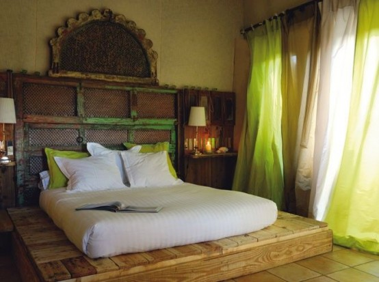 a platform bed instead of a usual one and a vintage carved headboard for a touch of boho