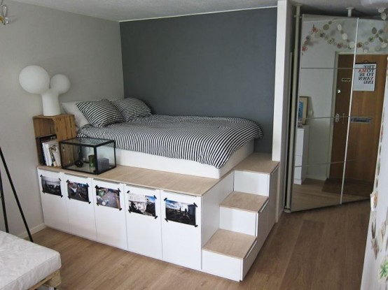 a space-saving platform with a sleeping space, drawers for storage and even photos attached