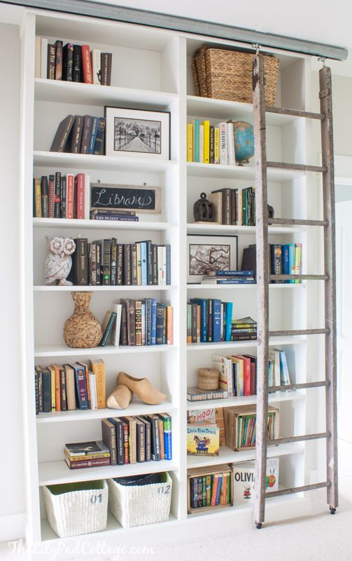 Adding a rustic moving ladder would add a special filling to simple Billy bookcases.