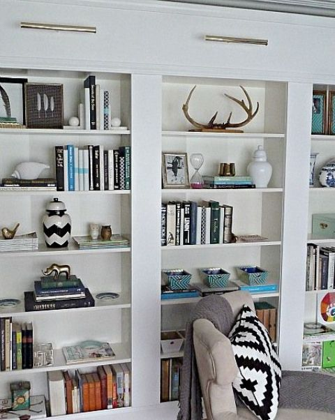 You can make a bunch of Billy bookcases look like a real built-in. It won't be a pricey project!