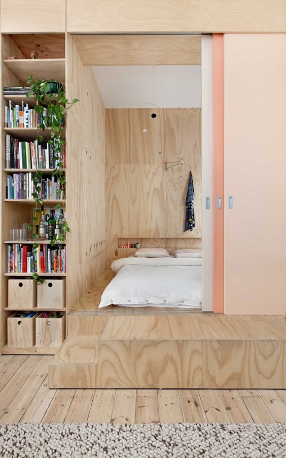 sliding doors hide the bedroom on a platform without wasting much space