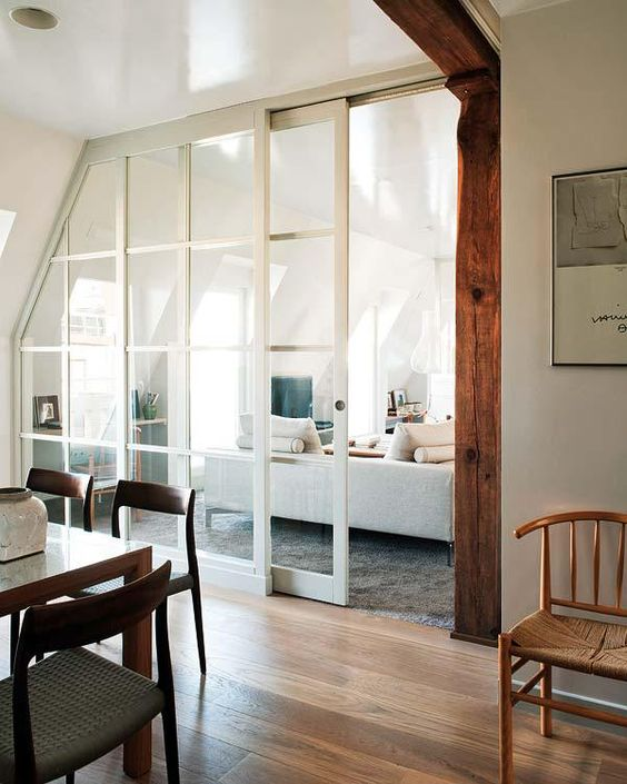 chic French sliding doors let the light in and out and separate the spaces without a bulky look