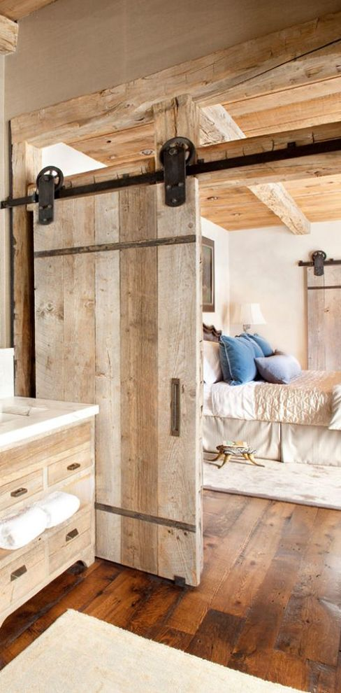 a rough wood sliding door for a rustic touch and cozy feel in the space