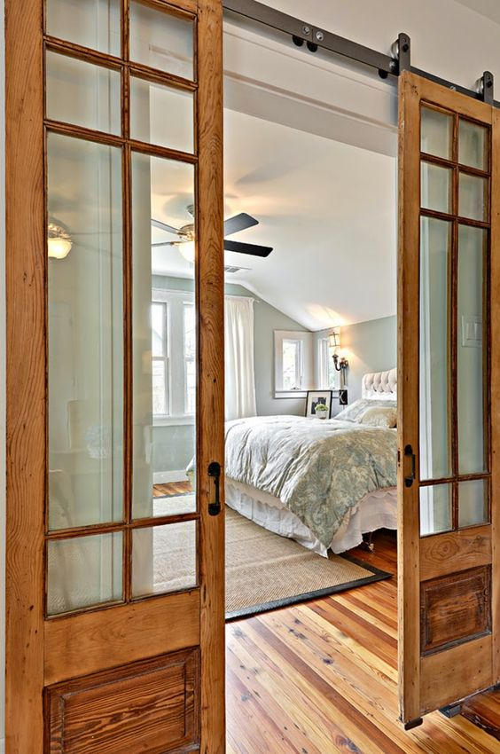 wood and glass sliding doors in a light shade for a rustic and cozy touch