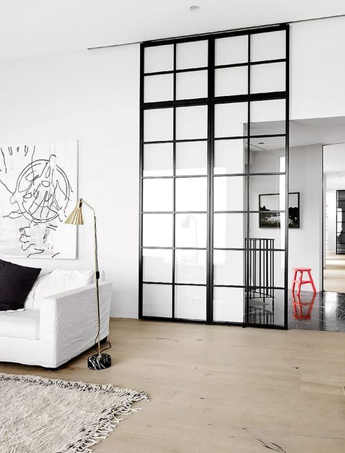 a glass framed sliding door to let light in and out and to make the space gently separated