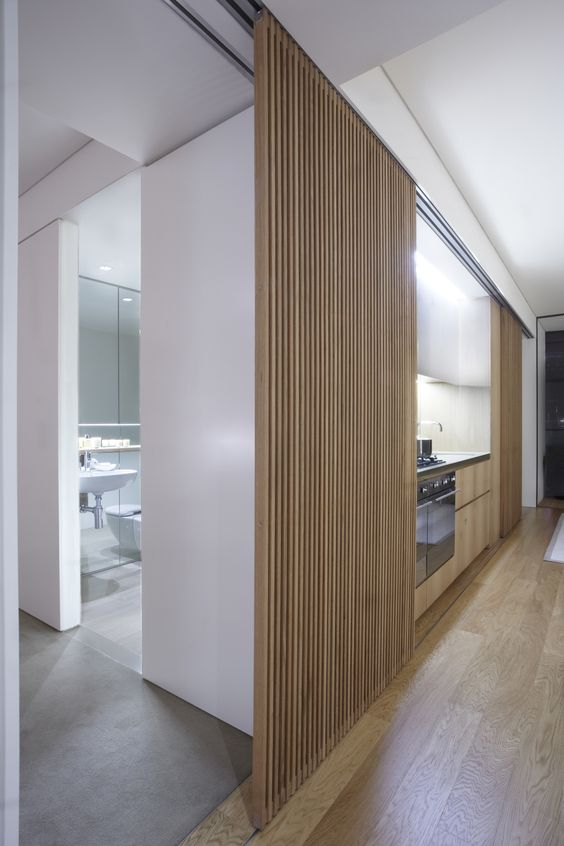 a wooden plank sliding door for a minimalist space