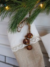 a burlap and lace stocking accented with rusty bells on twine is a very cozy rustic decor idea for Christmas