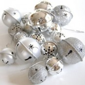 silver and silver glitter bells can be used throughout your home for Christmas decor – they brilliantly bring the spirit in