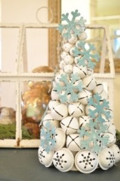 a white bell Christmas tree with blue glitter snowflakes is a gorgeous tabletop tree or decoration for any room