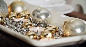 a white tray with silver and gold bells, tealights and silver and gold ornaments is a simple last-minute centerpiece or just decoration to rock