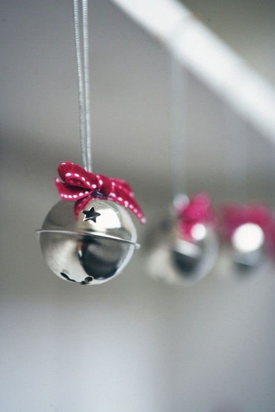 pretty silver bells with stars and little red bows can be used throughout the house to bring holiday spirit to it