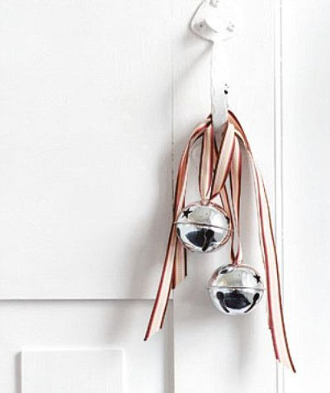 silver bells with striped ribbons can be hung not only a Christmas tree but also on doors