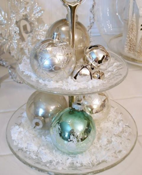 a glass stand with faux snow, silver and green ornaments and bells is a pretty and chic decoration in vintage style, make one easily
