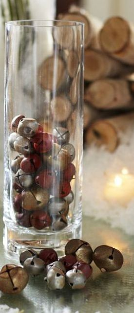 a tall glass vase with vintage rusty bells is an easy outdoor or indoor Christmas decoration and can be used to compose a centerpiece