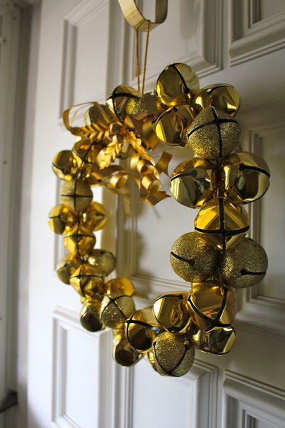 a gold bell and gold glitter bell Christmas wreath is a gorgeous and very glam holiday decoration to rock