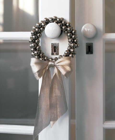 a wreath of silver bells and a silver bow is a lovely accent for your doorm, inner or outer