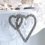silver bells shaped into heart Christmas wreaths are amazing to accent your space for winter holidays, rock them wherever you want