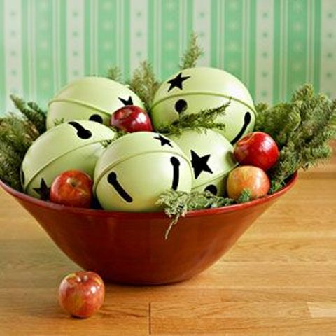 a red bowl with oversized green bells, with apples and fir branches is a very cool and chic idea to rock