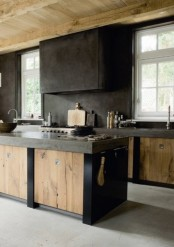 a rough kitchen with a wabi-sabi look, with metal and wood cabinets and a dark metal hood for a contrasting look