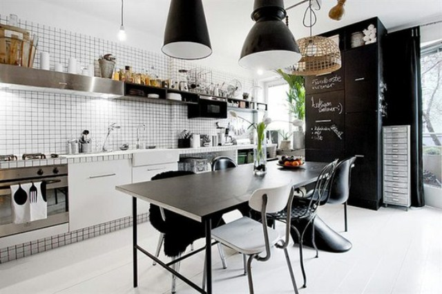 a monochromatic Scandinavian kitchen with white tiles, black furniture and touches of wood and rattan