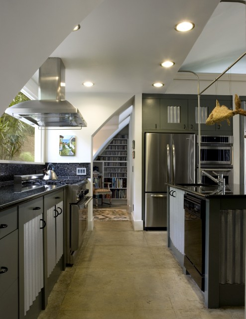 a dark green kitchen with sleek cabinets, white corrugated steel touches and built-in lights