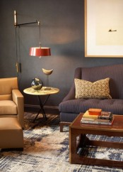 a stylish living room with upholstered furniture, a wooden coffee table, a wall lamp