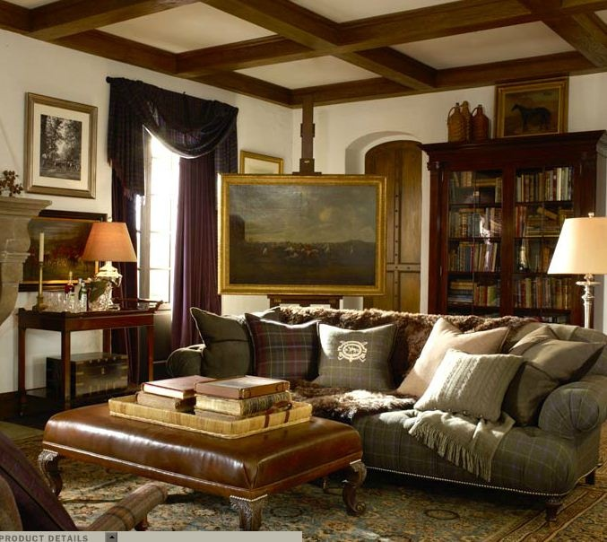 a traditional living room with refined wooden and upholstered furniture, an artwork, heavy draperies and lamps