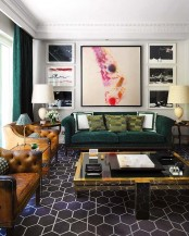 a bright modern meets art deco living room with leather and velvet furniture, artworks, a glass table and touches of gold