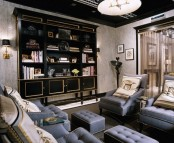 a moody and refined living room with blue furniture, a dark and gold shelvign unit, lamps and artworks