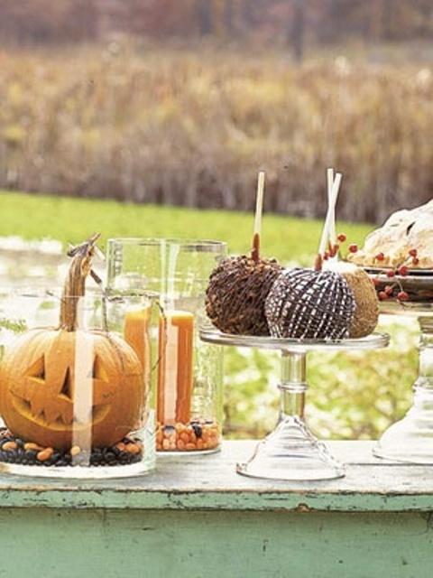 For a more sophisticated look put your jack-o-lanterns into big enough cylindrical vases.