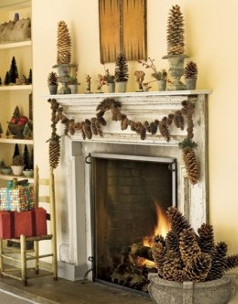 Pinecone topiaries and a pinecone garland is a great solution to dress up your fireplace for holidays.