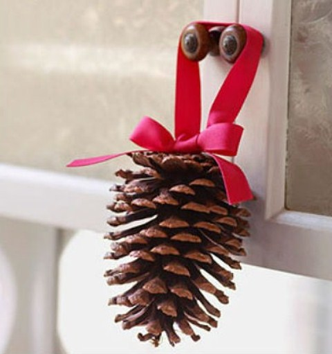 You can decorate kitchen cabinet doors with individual pinecones suspended on colorful ribbon pieces.