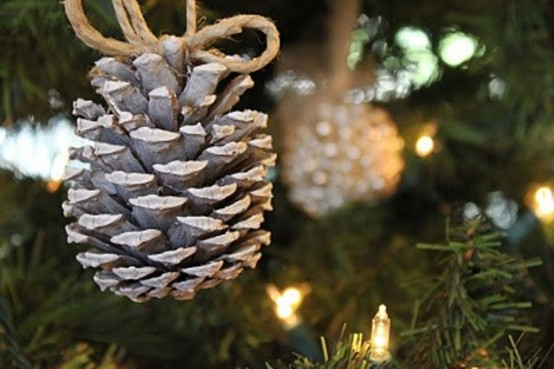 Suspend individual pinecones from an evergreen garland or from a Christmas tree using twine.