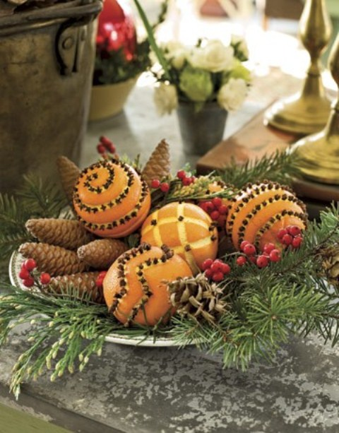 Pinecones, pomanders and holiday greens could easily become an awesome holiday arrangement for a table setting.