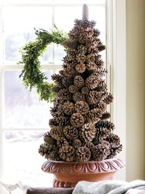 Make a  pinecone's Christmas tree alternative by gluing them together shaped like a spruce tree.