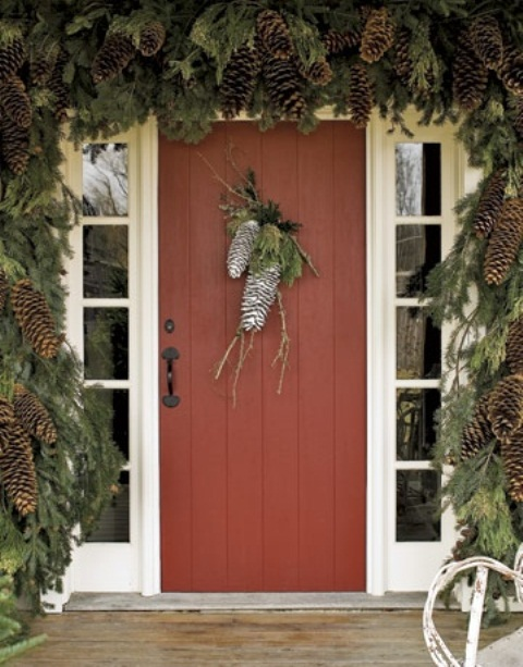 Gigantic pinecones painted with white sparkles could become a door hanger that would welcome your guests during winter.