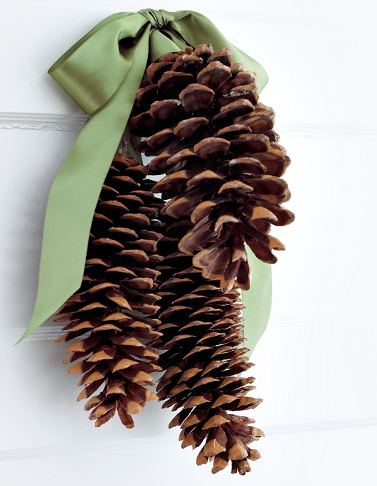 A DIY pinecone door hanger is probably the most easy craft project there is. It's perfect to make with your kids.