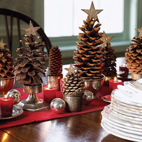 Pinecones in small vintage cups and buckets could resemble Christmas trees if you put shiny stars on top of them.
