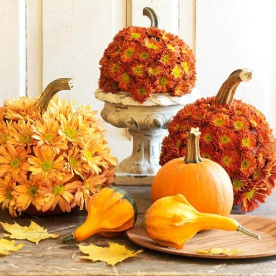 If you want to make a statement cover some pumpkins in your arrangement with mums.