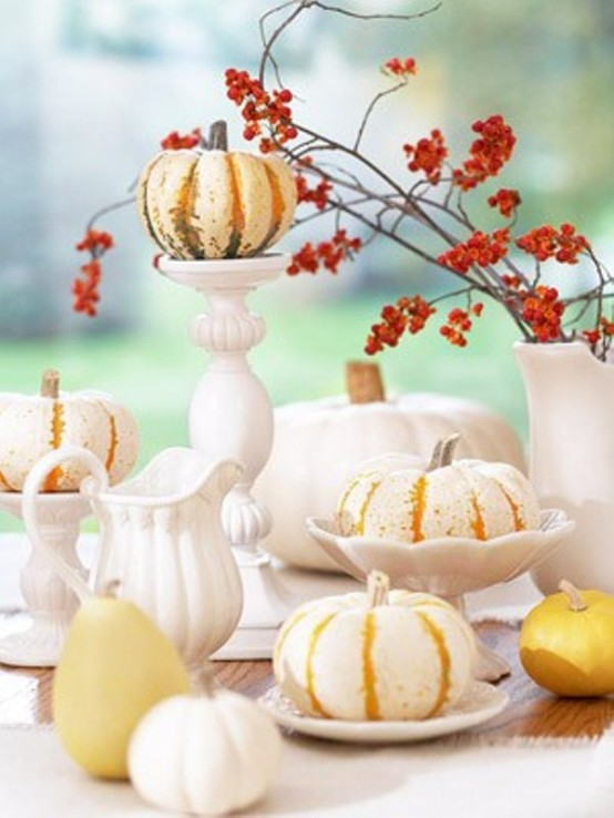 Painting pumpkins in white but leaving vertical orange stripes allows to create more original arrangements. You can use such arraignment as a centerpiece for Fall wedding.Arranging pumpkin centerpieces is quite popular for Fall weddings.
