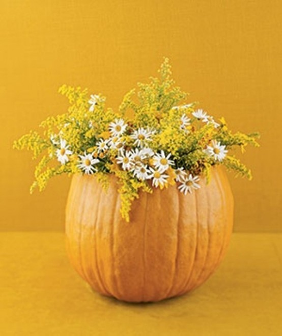 Hide a vase filled with water inside a pumpkin for a long-lasting Fall display.