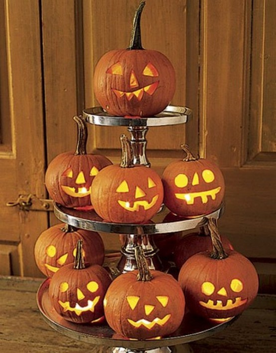 A bunch of glowing carved pumpkins could become a beatuiful centerpiece for Halloween.