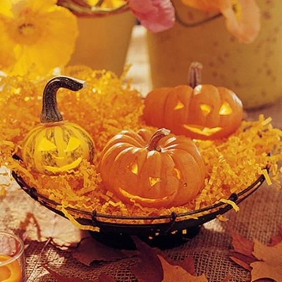 Pumpkin lanterns could delightfully brighten up an evening affair. Works as for Halloween as for a casual Fall dinner.