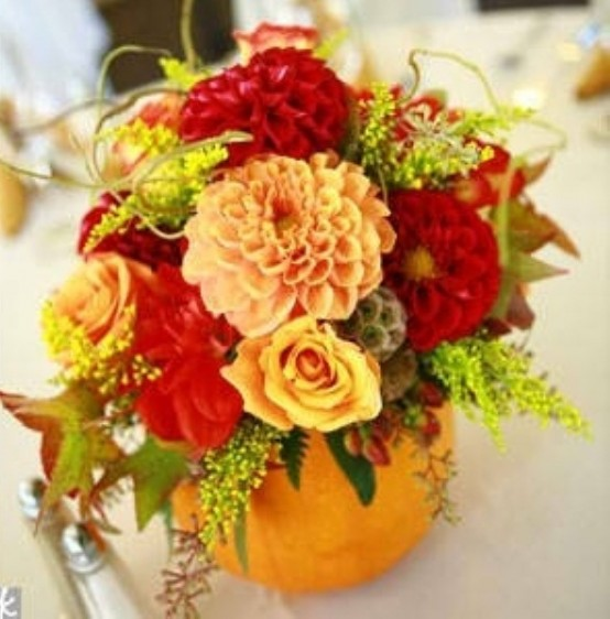 Simply carve a hole in a pumpkin and fill up with your favorite fall blooms.
