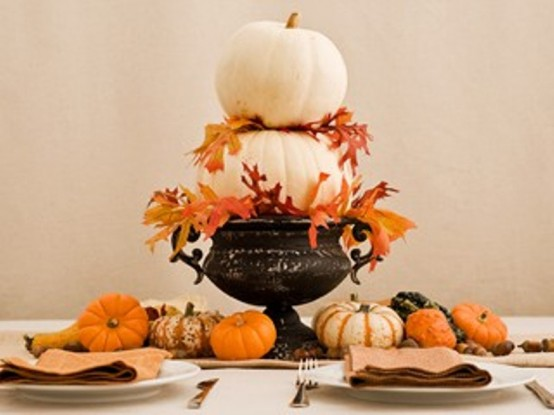 Choose several flat-bottomed pumpkins in graduated sizes and put them in a bowl. Add some fall leaves and a gorgeous centerpiece is done.