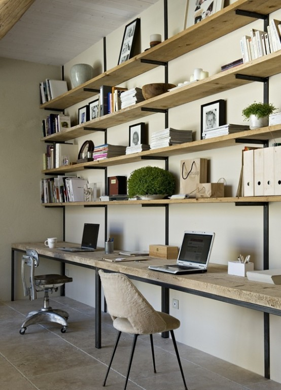 a modern rustic home office with a large open shelving unit and a desk attached under them, some chairs and accessories and decor