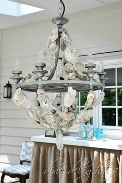 a vintage chandelier covered with seashells is a creative idea for a vintage beach home and it will finish off the space beautifully
