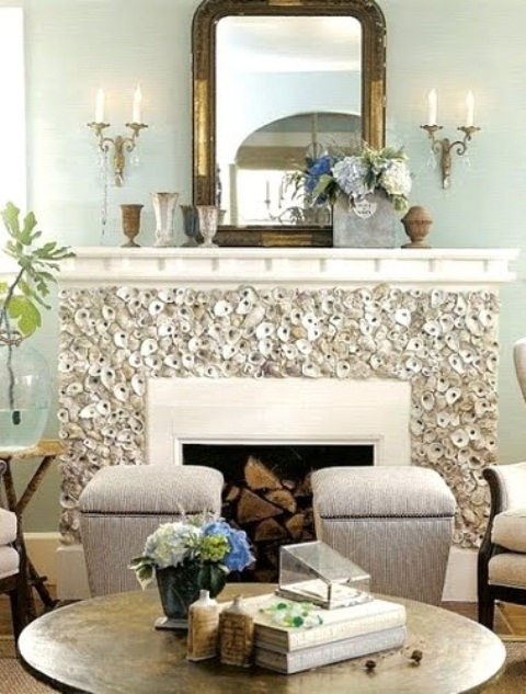 a fireplace clad with seashells is a bold and cool solution for a beach or seaside home