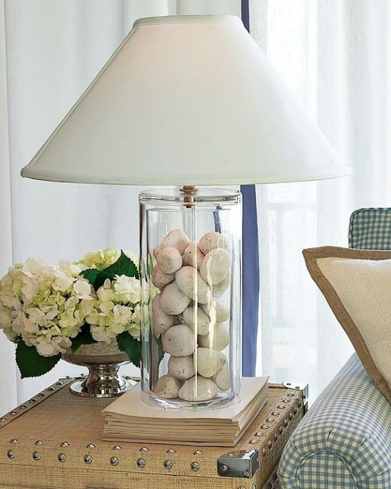 a stylish modern lamp with pebbles inside and a plain lampshade is a cool reminder of pebbly beaches and coasts